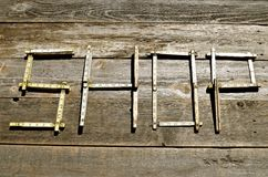 Folding rulers spell out SHOP Royalty Free Stock Photo