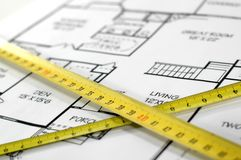 Folding rules and house architectural plan. House plans and folding rule , concept of home architecture Royalty Free Stock Photo