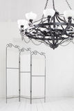 Folding screen and a black chandelier in a room Royalty Free Stock Photos