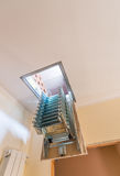 Folding staircase to attic room Royalty Free Stock Image