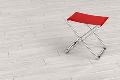 Folding stool on wooden floor Stock Photo