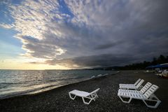 Folding sun loungers. On the beach royalty free stock photos
