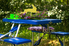 Folding table. With benches tourism blue with dishes royalty free stock photo