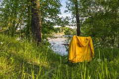 Folding travel chair river Stock Image