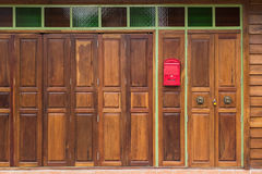 Folding wooden doors have a light  Red mailbox Royalty Free Stock Images