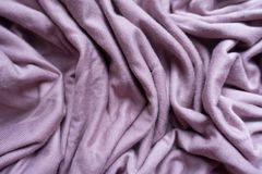 Folds of pink fabric from above. Folds of pink viscose fabric from above Stock Photography