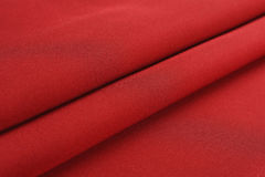 Folds of red cloth stock images