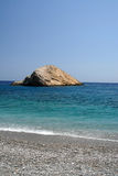 Folegandros - Cycklades - Greece. The Katergo . Clear water, bottom with green stone of Folegandros, deserted beaches Stock Images
