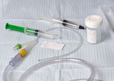 Foley Catheter. With specimen cup and patient name tag Royalty Free Stock Photo