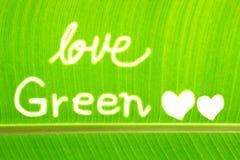 A folha da banana escreve o verde do amor Fotos de Stock Royalty Free