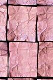 A folha de alumínio cor-de-rosa vincada esquadra no fundo preto Imagem de Stock Royalty Free