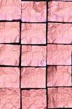 A folha de alumínio cor-de-rosa vincada esquadra no fundo preto Foto de Stock Royalty Free