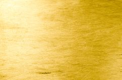 Folha de alumínio riscada como a cor dourada do fundo Lugar para t Fotografia de Stock