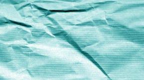 Folha de papel amarrotada com efeito do borrão no tom ciano foto de stock royalty free