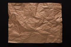 Folha de papel velha isolada no fundo preto Imagem de Stock