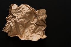 Folha de papel velha isolada no fundo preto Imagens de Stock