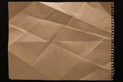 Folha de papel velha isolada no fundo preto Fotografia de Stock Royalty Free