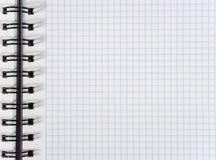 Folha esquadrada branca do caderno fotografia de stock