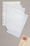 Folha limpa do caderno alinhado e de um cartão Foto de Stock