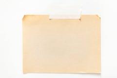Folha velha do papel do ofício isolada no fundo branco Imagens de Stock Royalty Free