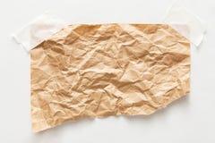 Folha velha do papel do ofício isolada no fundo branco Imagens de Stock
