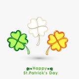 Folhas brilhantes do trevo para a celebração do dia de St Patrick Fotos de Stock