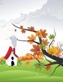 Folhas com uma casa na paisagem atrás   Fotografia de Stock Royalty Free