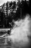 Folhas da motocicleta em um fumo foto de stock royalty free