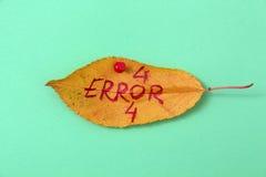 Folhas da noz do outono com texto escrito à mão Fotografia de Stock Royalty Free