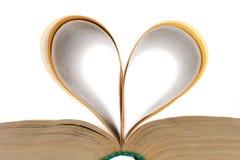 Folhas dadas forma coração do livro Fotos de Stock