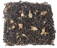 Folhas de chá verdes secas com jasmim no branco Foto de Stock Royalty Free