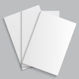 Folhas de papel brancas em um fundo cinzento Imagem de Stock