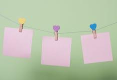 Folhas de papel na linha Fotografia de Stock