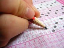 Folhas de resposta assinadas para locais da formação e do exame Foto de Stock