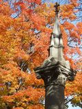 Foliage in Graveyard 3. Bright Fall foliage is a counterpoint to somber setting stock images