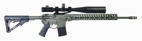 Foliage green AR15 Rifle with scope Stock Photography