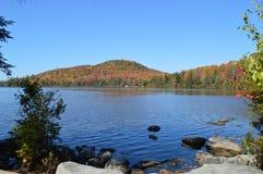 Foliage on Kettle Pond. In Groton, Vermont stock photos