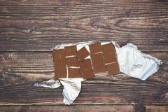 Folie und Schokolade lizenzfreie stockfotos