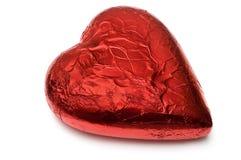 In folie verpakt rood chocoladehart Royalty-vrije Stock Afbeelding
