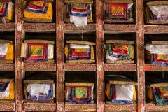 Folios of old buddhist manuscripts. Folios of old manuscripts in library of Matho gompa Tibetan Buddhist Monastery in Ladakh, India stock photos