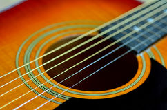 Folk acoustic guitar. Sound-hole of six-string folk acoustic guitar. close up royalty free stock photography