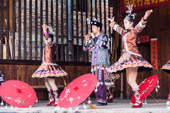 Folk actors with umbrellas in Dong Culture Show Stock Photography