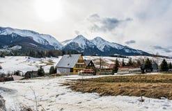 Folk architecture in Zdiar village with Belianske Tatry mountain Stock Photos