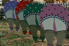 Folk art cut-outs of women bending over Royalty Free Stock Photos