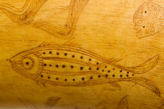 Folk art fish carving on 1800's powder horn Stock Images