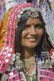 Folk Art Market Annual event in Santa Fe, NM USA. Woman from India in colorful costume with silver jewelry. International Folk Art Market held annually in Santa Royalty Free Stock Photos