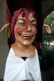 Folk Art Mask Big Head Smile. A great example of the Catalonian large head folk art masks called gigantes y cabezudos with a red bow Royalty Free Stock Photo