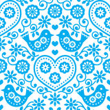 Folk art seamless blue pattern with flowers and birds Stock Image