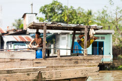 Folk av den Mekong deltan, Cai Be, Vietnam Fotografering för Bildbyråer