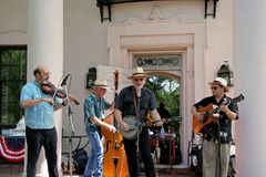 Folk Band. A four piece folk band called The Lonestar Bluegrass Band.  This was an even in Houston for the 4th of July.  The band is one of the highest rated Stock Photo